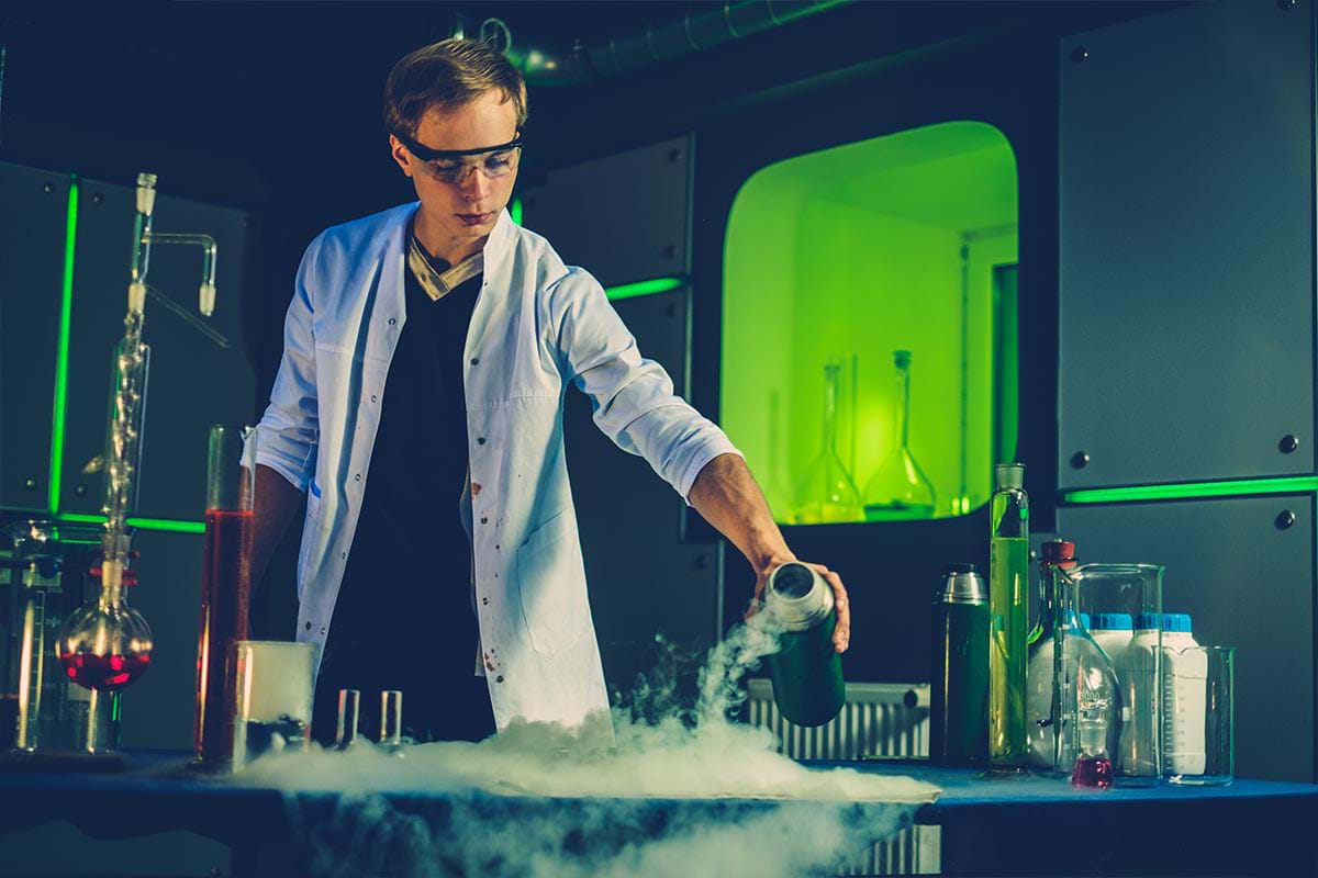 Photograph showing a male student working on a scientific experiment