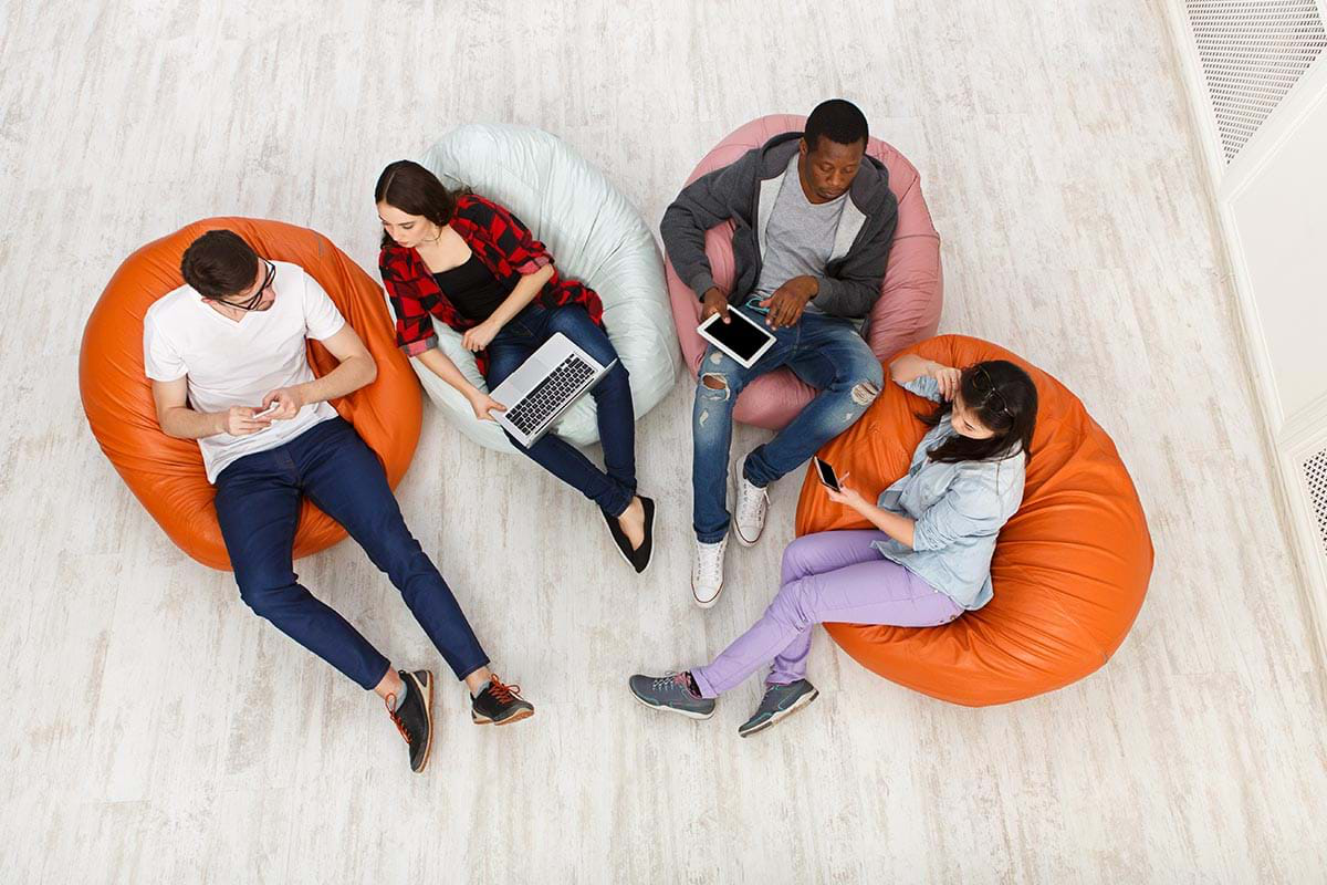 Photograph showing a birds eye view of three students relaxing on bean bags